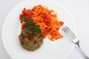 Nut pattie with orange red salad